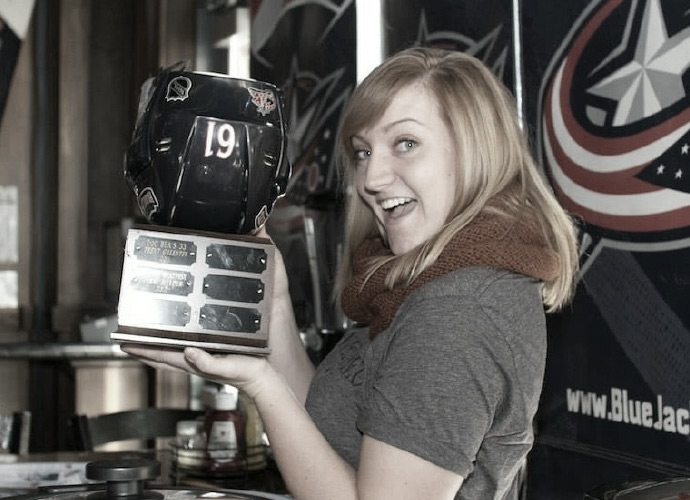 Redheaded woman holding Chili Bowl award for best chili recipe